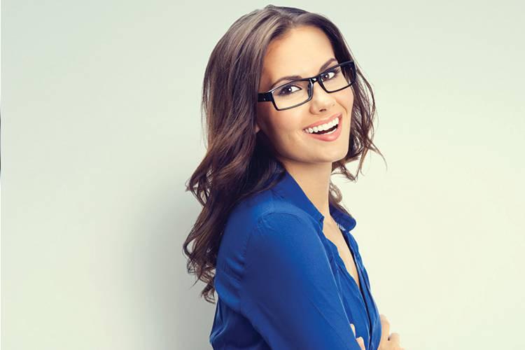 Business woman smiling wearing eye glasses.
