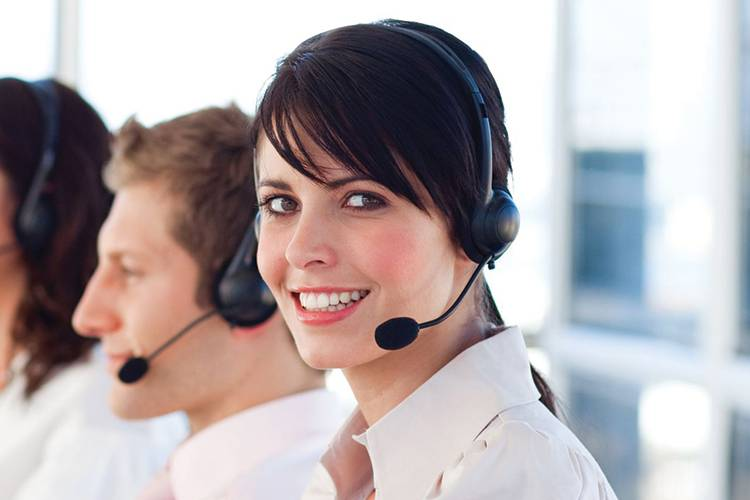 Smiling Contact Center woman with headset.