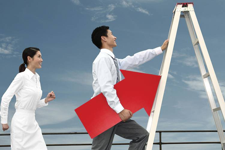 Man climbing a ladder holding a large red arrow followed by a woman and man.